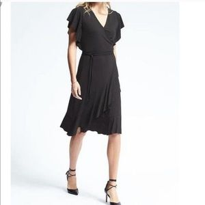 Like new BR Flounce black wrap dress